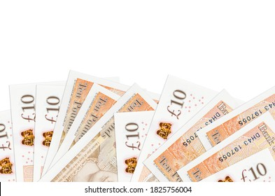 10 British pounds bills lies on bottom side of screen isolated on white background with copy space. Background banner template