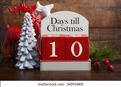 10 Days till Christmas vintage style wood calendar with red and white reindeers and decorations, spotlighted against a rustic wood background.