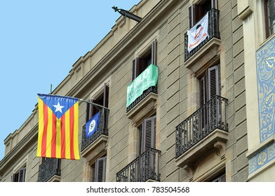 10 DECEMBER 2018: Flags and banners on a Barcelona apartment block show the residents' support for Catalonia's independence from Spain.