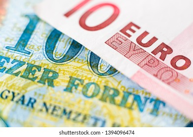 10 Euro banknote on a 100 Forint bank note