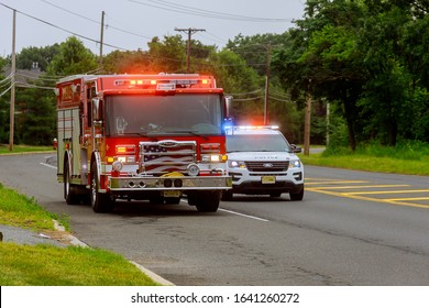 10 February 2020 East Brunswick NJ USA: Fire Trucks in Fire Department on emergency 911 and police car