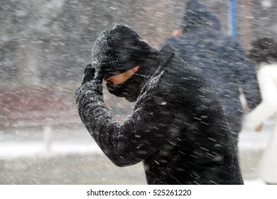 10 January 2005, Istanbul Turkey. A man walks under a heavy snow in downtown Istanbul.