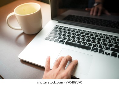 10 January 2018;Bangkok THAILAND ; ; Business woman work in starbuck coffee shop with macbook laptop computer and take a cup of latte coffeee