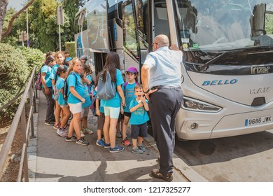 10 JULY 2018, BARCELONA, SPAIN: group of happy kids on a school excursion near the bus