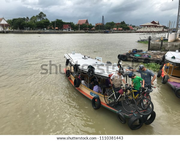 10 June 2018, Nonthaburi, Thailand: people take a ferryboat cross the river, Chao Phraya, the water public transportation.