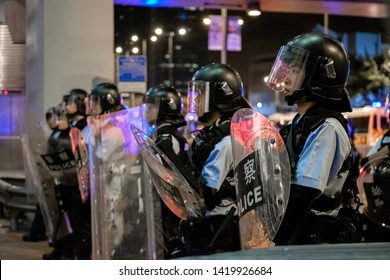 10 June 2019 - Hong Kong Anti-extradition Protest: Protesters refused to clear from the driveway.  Police were performing riot control towards unarmed protesters.