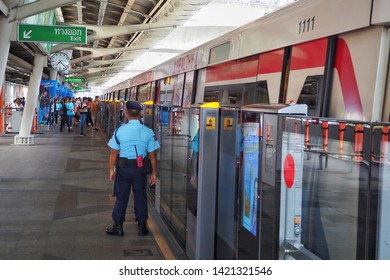 10 June 2019, Security guard standing for take care of safety at BTS skytrain ,Bangkok , Thailand.
