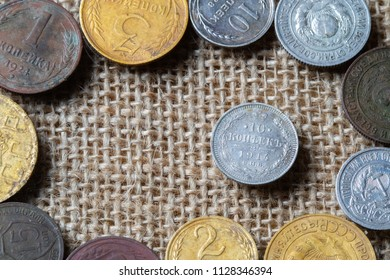 10 kopecks in 1914 is surrounded by ancient coins of Russia, fabric background and coins