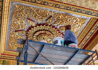 10 March 2019 , The artist renovate the roof of the Golden Castle with beautifully carved gold carvings in Wat Thasung , Uthaithani ,Thailand