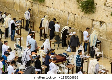 10 May 2018 Jewish men in prayer shawls and phylacteries pray fervently toward the traditional holy place at the western wall in Jerusalem Israel