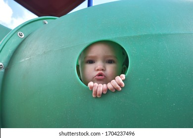 10 Month Old Baby Girl Playing in a Playground Tunnel at Park