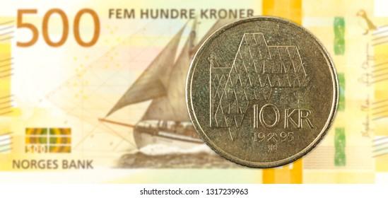 10 norwegian krone coin against 500 new norwegian krone banknote