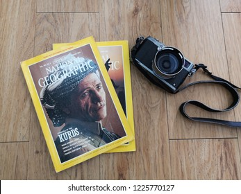 10 November 2018. Bangi. Read magazine when waiting for boarding. National Geographic Magazine and Fujifilm Camera