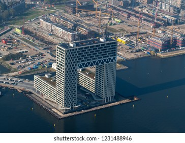 10 October 2018, Amsterdam, Holland. Aerial bird view of new Dutch landmark. The Ponsteiger residential building in the Houthaven at river IJ. Still under construction but nearly finsihed.