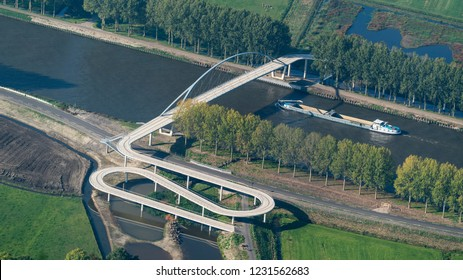 10 October 2018, Nigtevecht, Holland. Aerial view of the new bridge Liniebrug over the canal Amsterdam-Rijnkanaal. It is a pedestrian and bicycle bridge near Abcoude and Nigtevecht. A boat is passing.