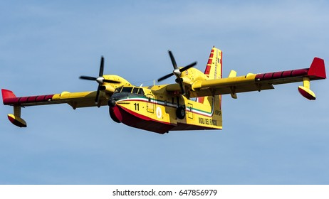 10 September 2016 Bombardier  415 Superscooper CL-415 Canadair take water from the Viverone Lake near Turin, Italy. This amphibious airplane is used by Protezione Civile for aerial firefighting.