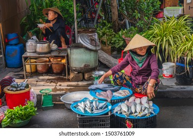 10 SEPTEMBER 2019: Asiatic fishwife selling fish in an asiatic market. Vietnamese woman vendor with fish market sand. Hoi An , Vietnam
