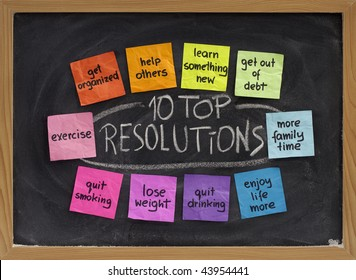 10 top new year resolutions - colorful sticky notes on blackboard with white chalk texture