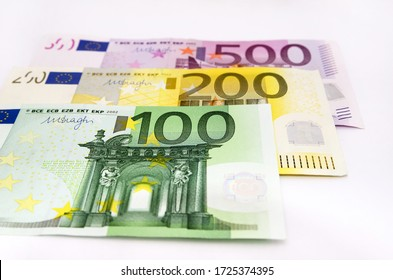 100, 200 and 500 euro banknotes on white. Close-up.