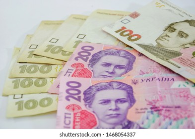 100 and 200 hryvnia banknotes isolated on white background