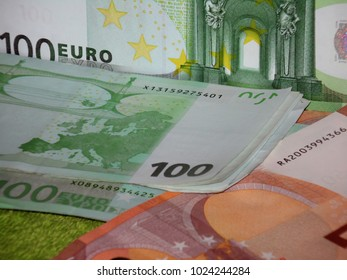 100 and 50 euro banknote on green background