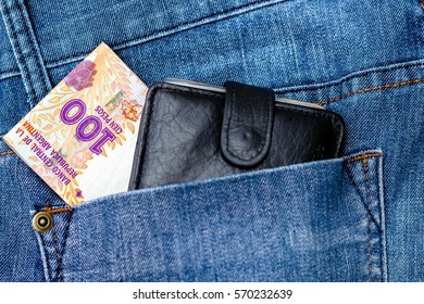 100 Argentine pesos on the jeans