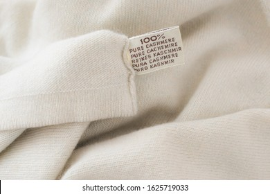 100 % cashmere label on cashmere background
