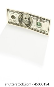 100 dollar bill standing on end, backlit on white background, copy space