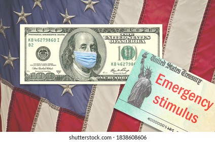 100 dollar bills with face mask and with US Treasure illustrative check in envelop to illustrate coronavirus stimulus payment on wooden background