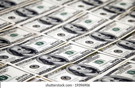 $100 dollar bills over table