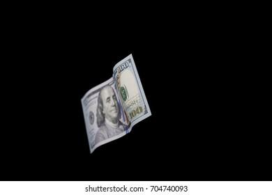 100 dollar isolated on black background