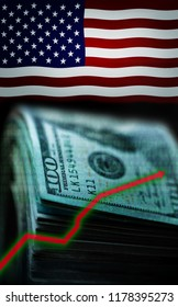 100 dollars bills and graphics rising on USA flag background extreme close up