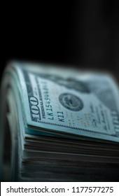 100 dollars bills on dark background extreme close up