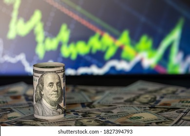 100 dollars curled up. Macro shot and background financial chart - Shutterstock ID 1827394793