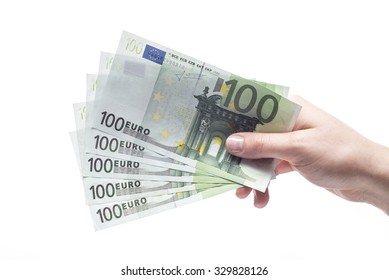 100 euro banknotes hold in hand isolated on white background