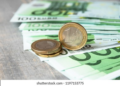 100 Euro banknotes and metal coins of 1 Euro, the European currency, the concept of income and inflation the budget