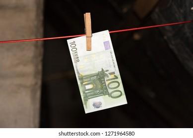 100 Euro bill on a clothesline