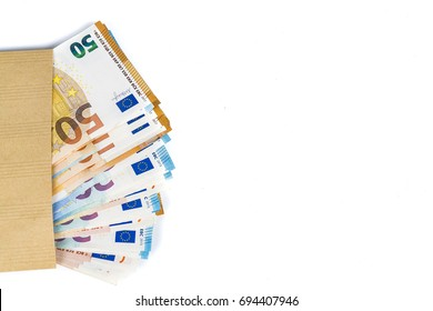 100 euro bills banknotes inserted between pages of european French passport. Concept price travel, backchich. Top view, close-up