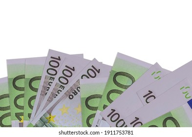 100 Euro bills lies on bottom side of screen isolated on white background with copy space. Background banner template for business concepts with money