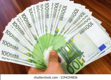 100 euro cash money banknotes in hand