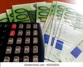 100 euro note and calculator