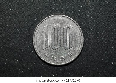 100 japanese yen coin on black color background
