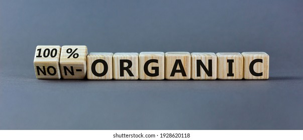 100 percent organic symbol. Fliped wooden cubes and changed words non-organic to 100 percent organic. Beautiful grey background, copy space. Business, healthy lifestyle 100 percent organic concept. - Shutterstock ID 1928620118