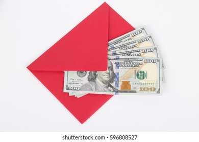 100 US dollar bills in an envelope isolated on white background