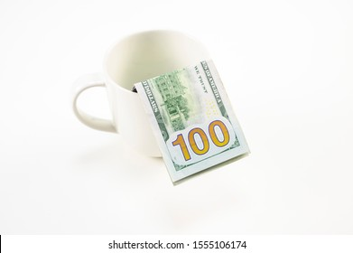 100 USD dollar banknote in white mug with white background.