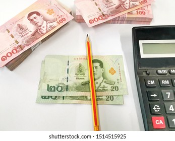1,000 baht, 100 baht, 20 baht Thai banknotes placed on a white background, business investment concept