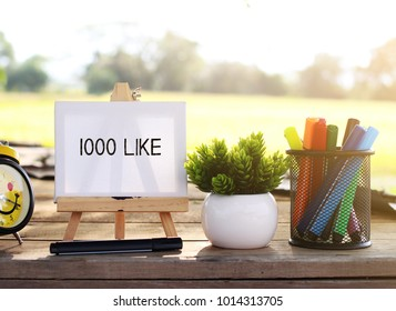 1000 like writing on small canvas