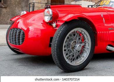 1000 Miles 2019, Brescia - Italy. May 14, 2019:  The historic Mille Miglia car race. A beautiful historical red car of Ermini on the narrow street of Brescia before the start of the race.