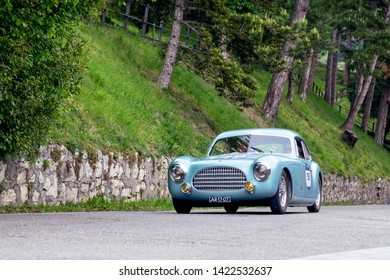 1000 Miles 2019, Brescia - Italy. May 15, 2019:  The historic Mille Miglia car race. Start of the race in Brescia. A beautiful vintage car on the race Mille Miglia on the road in the castle of Brescia
