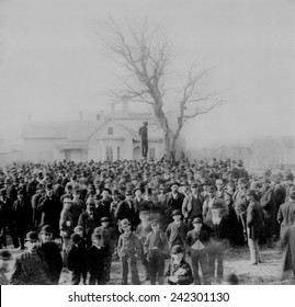 1000 people gather to see the body of African American Frank McManus hanging from a tree in Minneapolis, Minnesota, three hours after his 4 AM lynching on April 28, 1882.